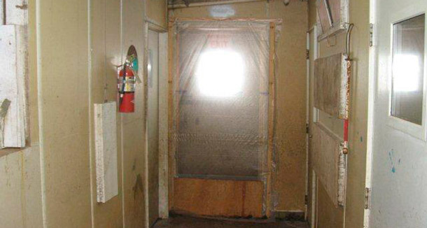 "Example of sealed door system that prevent unwanted air transfer and the convenient yet inappropriate movement of personnel between the ""clean"" (inside) and the ""dirty"" (outside) zones of the facility"